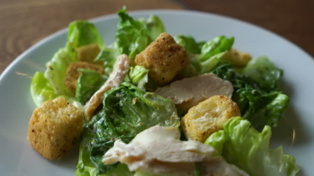 caesar salad with chicken caesar salad with chicken cooked stock videos & royalty-free footage