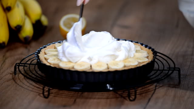 Cake Banoffi with caramel and banana. Banoffee pie with whipped cream