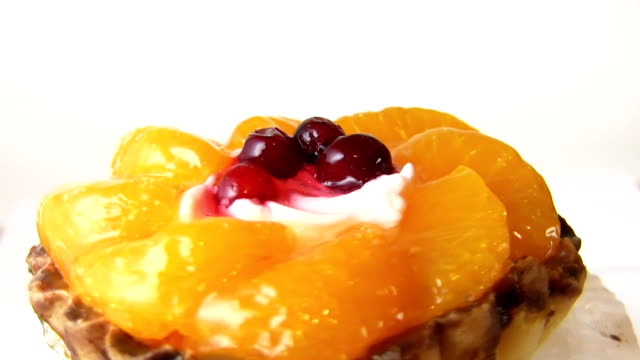 cake with fruit, rotates video