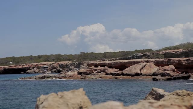 cala conta ibiza beach, image at ground level in an ibiza cove - formaggio comté video stock e b–roll