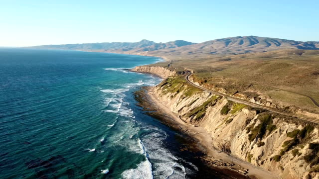 California coastline with mountains and train tracks from above video