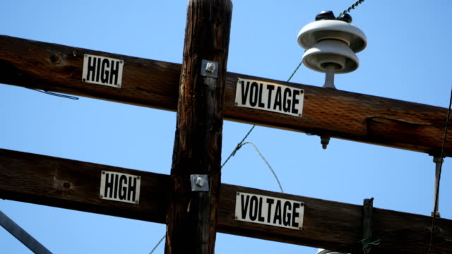 California High voltage pole in 4K Professional video of California high voltage pole in 4K high voltage sign stock videos & royalty-free footage