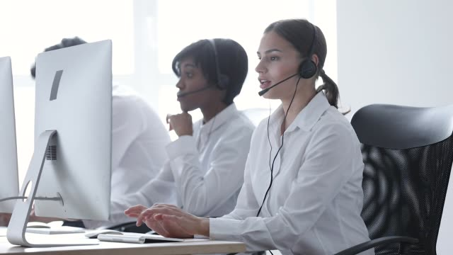Call Center. Smiling Woman In Headset Working At Computer
