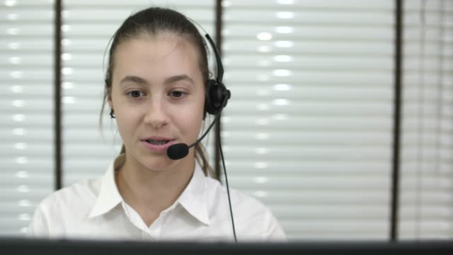 Call center workers wearing headsets Customer Support Worker in Call Center with Headset russian ethnicity stock videos & royalty-free footage