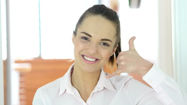 Call Us Gesture by Beautiful Woman in Office video