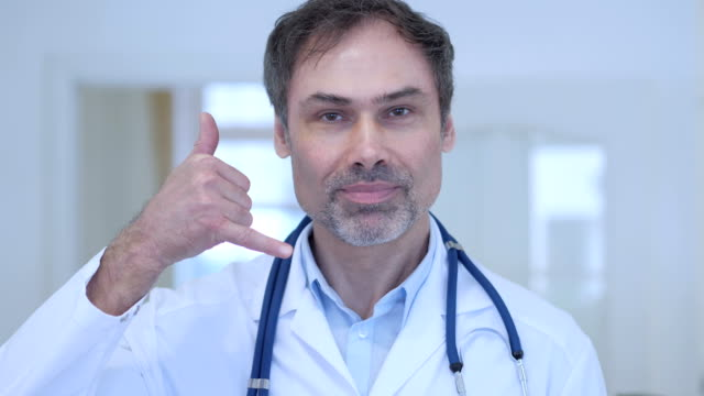 Call Us Gesture by Doctor in Hospital video