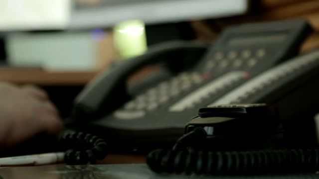 Call-center operator answering the phone, support service, helpdesk information