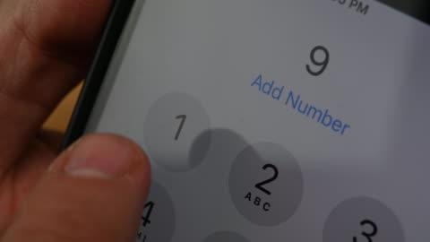 vídeos de stock e filmes b-roll de calling 911 emergency number - a usar um telefone
