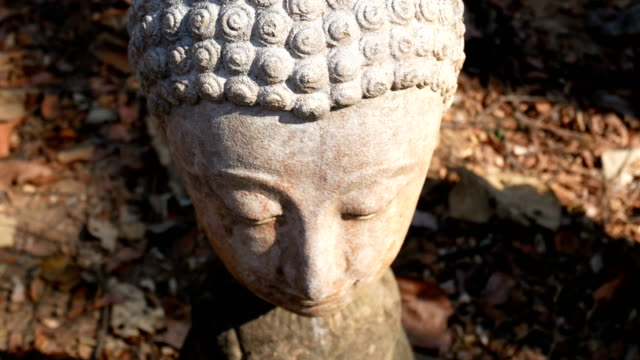 4k. calm and peaceful face of old worship buddha statue head illuminated. buddha statue at chiangmai history temple. chiang mai province, thailand , asia - buddha video stock e b–roll