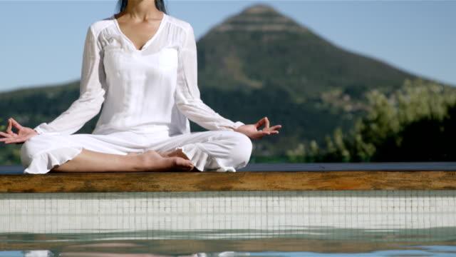 Calm brunette doing yoga video