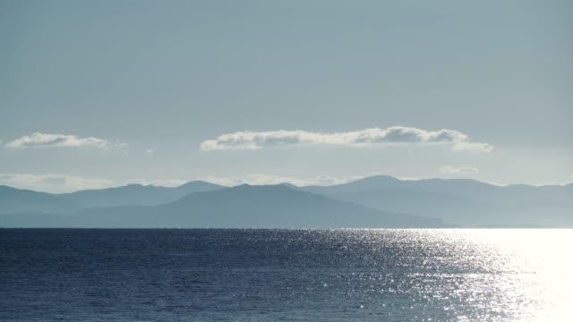calm sea at morning, greek coast peloponnese mani, time lapse - пелопоннес стоковые видео и кадры b-roll