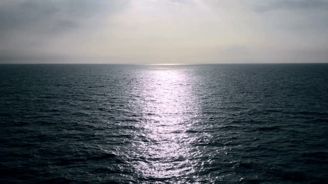 Calm serene scenery blue sky rippled water surface reflection open sea seascape video