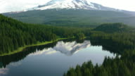 istock AERIAL Calm surface of a lake in the forest reflecting the beautiful Mount Hood in the background 864526000