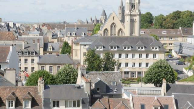 Calvados capital Caen in France cityscape 4K Calvados capital Caen in France cityscape 4K 3840X2160 UltraHD 30fps tilting footage - City of Caen located in northern French region Normandy slow tilt 4K 2160p UHD video caen stock videos & royalty-free footage