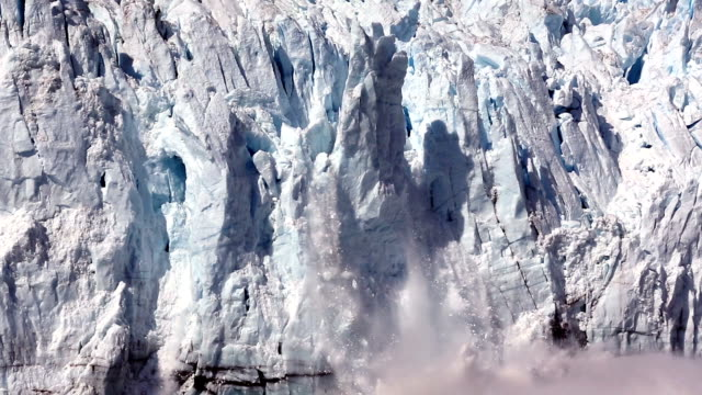 Calving Glaciers giant 50 meter sheets of ice falling from a massive glacier at Margerie Glacier in Glacier Bay, Alaska, USA. breaking stock videos & royalty-free footage