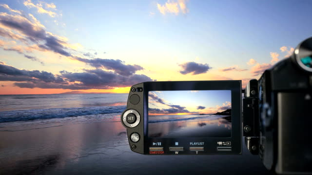 Camcorder recording sunset on beach video