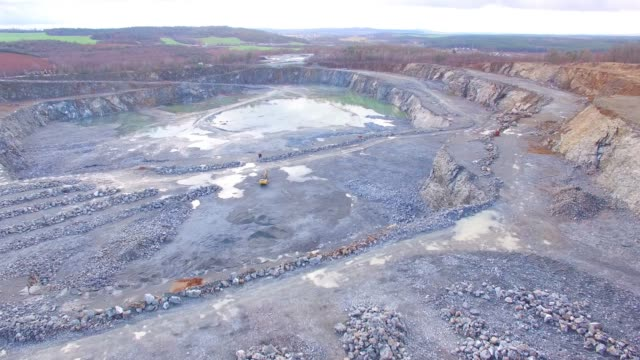 Camera flight over a open cast mine.  Heavy industry from above. Industrial landscape in Central Europe.