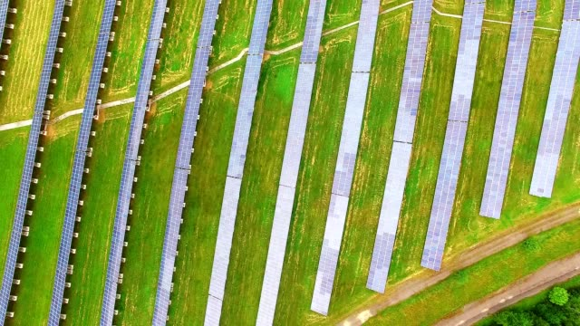 Camera flight over a solar power station. Camera flight over a solar power plant in agricultural landscape. Industrial background on renewable resources theme. Industry of power and fuel generation in European Union. biofuel stock videos & royalty-free footage