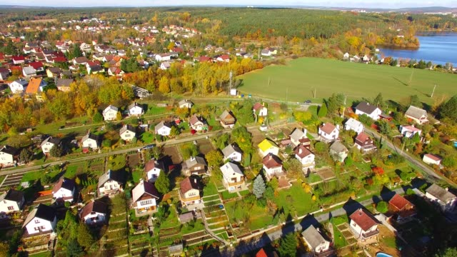 Camera flight over area for pleasant living in suburban district. Urban landscape in Czech Republic, Europe. Camera flight over area for pleasant living in suburban district. Urban landscape in Czech Republic, Europe. country geographic area stock videos & royalty-free footage