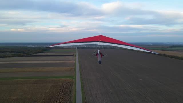 Camera follows real hang glider wing in flight.