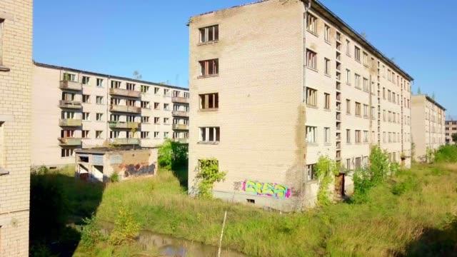 Camera goes between abandoned buildings video