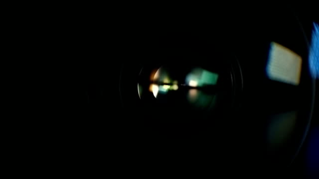 Camera Lens Reflection. Color Lens Flare Camera lens reflection macro with color lens flare. LED lamp camera photographic equipment stock videos & royalty-free footage