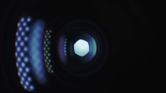 stockvideo's en b-roll-footage met camera lenssluiter - lichtreflecties - photography curtains