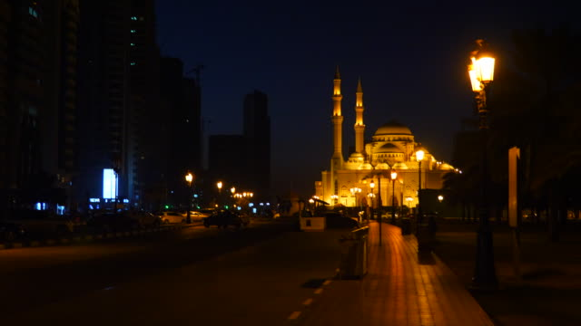 Camera motion from mosque to crescent. Dark arabian night. Mosque illuminated with gold lights. Lanterns at path pedestrian road. video
