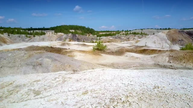 camera moves above clay quarry smoothed slope tops