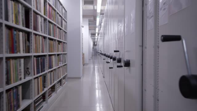 4K - Camera moves around the book storage video