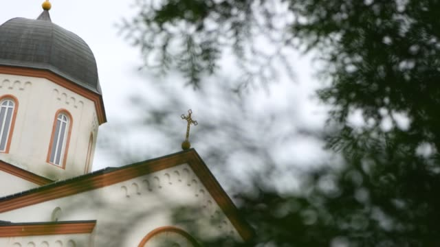 Camera moves past the white blue Orthodox Church video