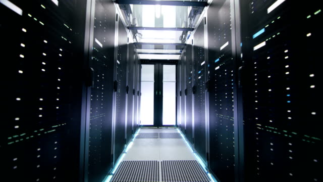 Camera Moving Backwards in Working Data Center Shot. Rows of Rack Servers, Glass Ceiling and LED Lights are Seen. Camera Moving Backwards in Working Data Center Shot. Rows of Rack Servers, Glass Ceiling and LED Lights are Seen. Shot on RED EPIC-W 8K Helium Cinema Camera. backup stock videos & royalty-free footage