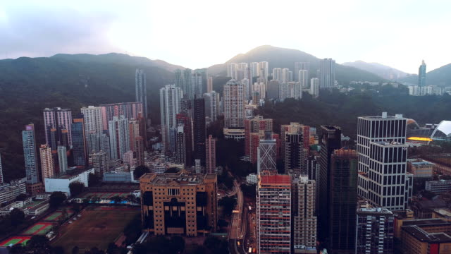 AERIAL. Camera moving from down to top. View of Hong Kong city down town area.