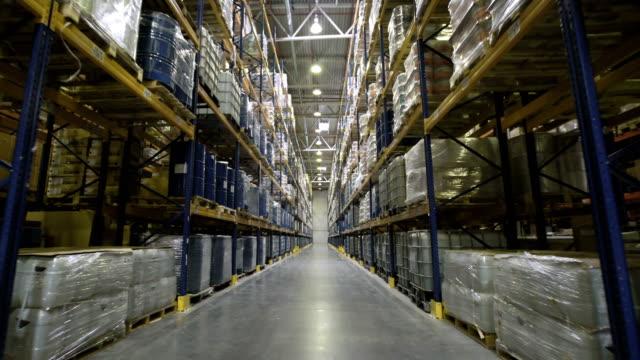 Camera moving through warehouse video