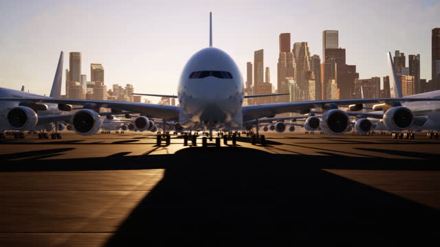 kameraschwenken über zahlreiche jumbo jets, die aufgrund einer globalen pandemie auf einer start- und landebahn des stadtflughafens gelandet sind - asphalt stock-videos und b-roll-filmmaterial