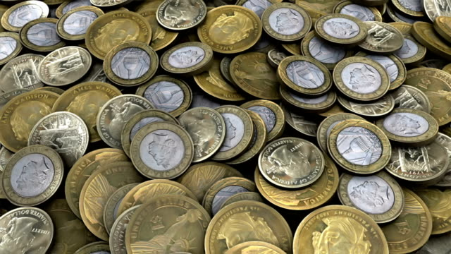 Camera panning over currency or coins video