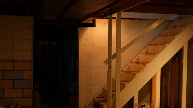 camera pans across an unfinished basement of residential home - basement stock videos & royalty-free footage