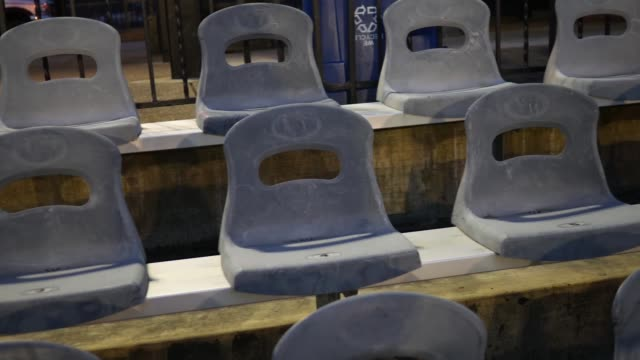 Camera pans over empty chairs at a sporting event at night video