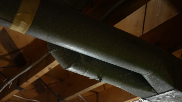 Camera pans over taped side of air duct work in basement Camera pans over taped side of air duct work in basement blood flow stock videos & royalty-free footage
