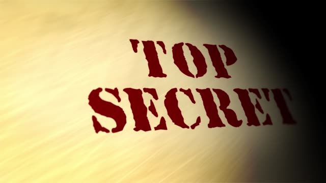 Camera pans over Top Secret document