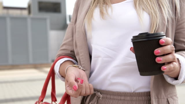 Camera rotation around a girl with a cup of hot drink video