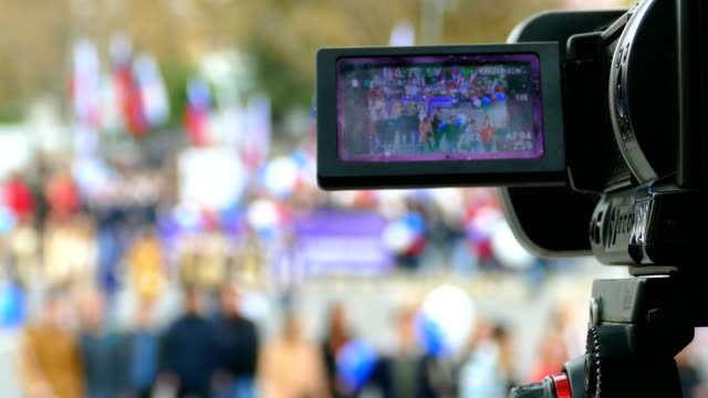 camera shoots a reportage about the demonstration video