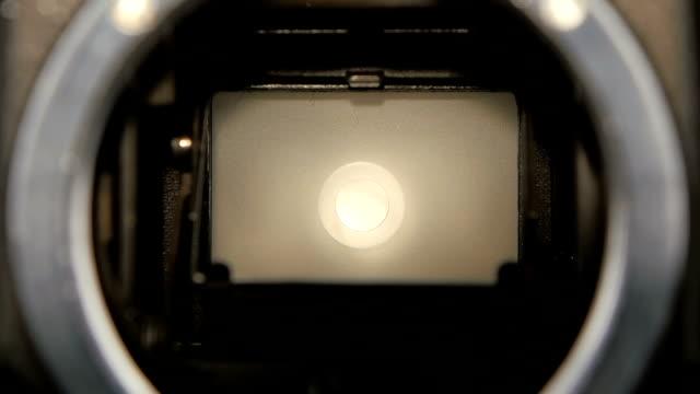 Camera shutter aperture transition in slow motion. Closeup camera lens video