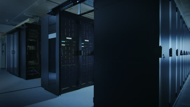 Camera Slide-Trough Shot of a Working Data Center With Rows of Rack Servers. Led Lights Blinking and Computers are Working. Dark Ambient Light. Green Shading. Camera Slide-Trough Shot of a Working Data Center With Rows of Rack Servers. Led Lights Blinking and Computers are Working. Dark Ambient Light. Green Shading. Shot on RED EPIC-W 8K Helium Cinema Camera. supercomputer stock videos & royalty-free footage