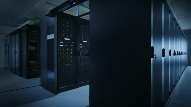 Camera Slide-Trough Shot of a Working Data Center With Rows of Rack Servers. Led Lights Blinking and Computers are Working. Dark Ambient Light. Camera Slide-Trough Shot of a Working Data Center With Rows of Rack Servers. Led Lights Blinking and Computers are Working. Dark Ambient Light. Shot on RED EPIC-W 8K Helium Cinema Camera. supercomputer stock videos & royalty-free footage