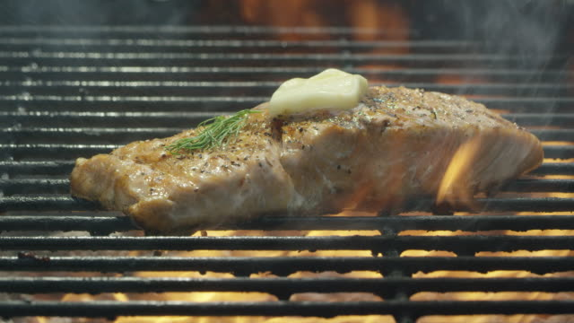 Camera Slowly Reveals a Seasoned Salmon Steak Filet with Dill and Butter Cooking Over a Bed of Coals on a Barbecue Grill Camera Slowly Reveals a Seasoned Salmon Steak Filet with Dill and Butter Cooking Over a Bed of Coals on a Barbecue Grill fillet stock videos & royalty-free footage