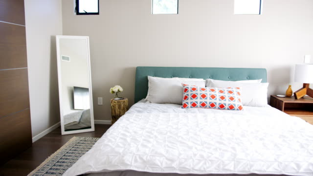 Camera tracks around contemporary bedroom