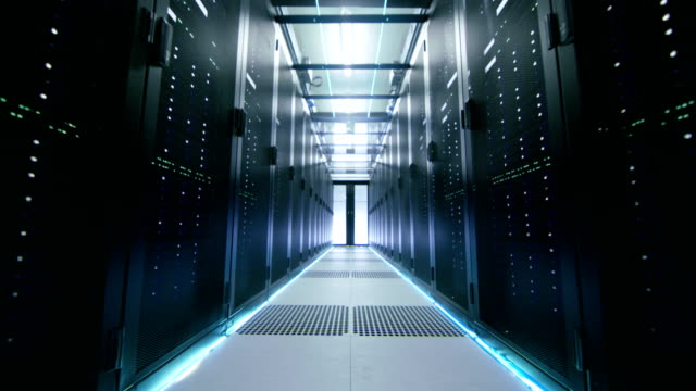 Camera Walk-Trough Shot of a Working Data Center With Rows of Rack Servers. video