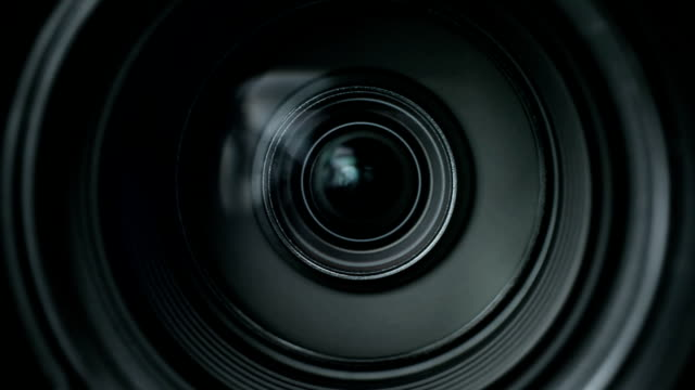 Camera zoom Camera zoom. Closeup shot of professional video camera, with its lens zooming in and out. camera photographic equipment stock videos & royalty-free footage