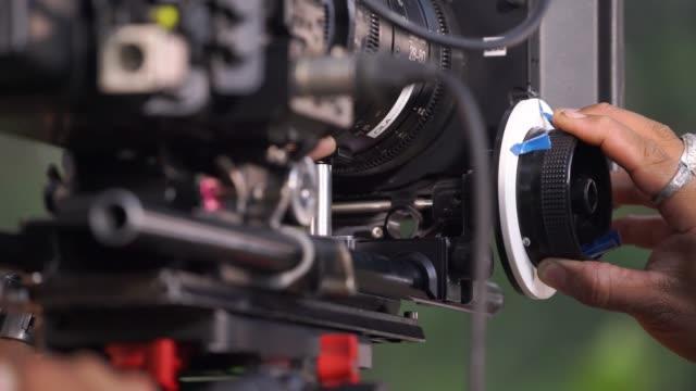 cameraman focusing on follow focus on video camera